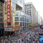 Chicago Theatre 2010 Bank of America Chicago Marathon Participants passing the Chicago Theatre