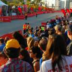 Finish Line Back on Columbus Drive, spectators wait to cheer on participants as they cross the finish line.