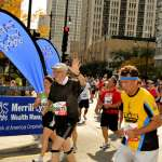Roosevelt Road Participants turn onto Roosevelt Road and are rallied on by spectators at the Merrill Lynch Cheer Zone.