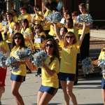University Village Students cheer on participants as the run through University Village.