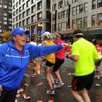 Volunteers Volunteers keep participants hydrated as the make their way down State Street.