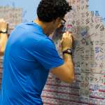Runner signing wall