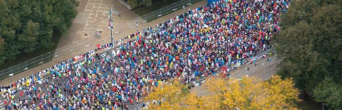 Aerial photo of runners in start corrals at the Bank of America Chicago Marathon