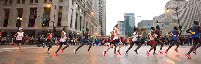 Elite athletes running through Chicago's Loop neighborhood