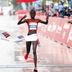 Brigid Kosgei crossing the finish line