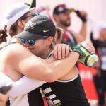 Runners hugging at the finish line